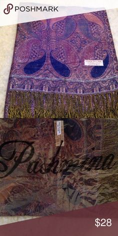 Pashmina paisley  scarf. 55% pashmina 45% silk. Purple, blue, pink. Has beautiful Shimmer, and fringes (gold and black) on the end as seen in pic. Third pic shows how it looks out of the bag. Accessories Scarves & Wraps