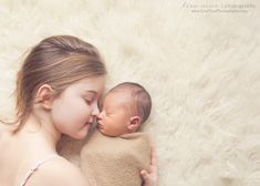 So precious! Going to remember this one...it can be hard to pose an older sibling with a newborn!