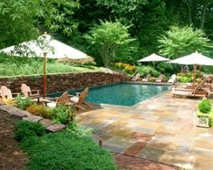 Nice tile around the pool, maybe someday mine can look like that