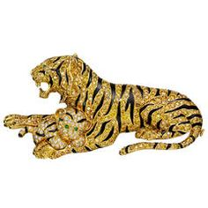 Van Cleef & Arpels Yellow Diamond Tiger Mother and Cub Brooch   From a unique collection of vintage brooches at https://www.1stdibs.com/jewelry/brooches/brooches/