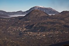 Air panoramic view with Mount Alpi on the background.