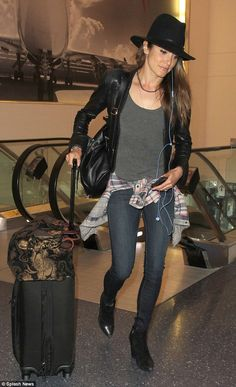 Flying solo: Nikki Reed arrived at the Los Angeles International Airport on Tuesday, trave...