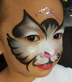 Butterfly strokes created a cute kitten Girl Face Painting, Face Painting Tips, Face Painting Designs, Kitty Face Paint, Face Paint Makeup, Halloween Makeup For Kids, Kids Makeup, Animal Face Paintings, Animal Faces