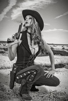 ~ Blowing away the last vestige of smoke/gun powder from her gun.  One of the Las Malas Chicas gang.  Costume by Ravenna Old & New West Vestures. ~
