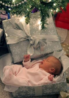 @Stacy Hoffman  photo: baby in a wrapped package under the Christmas tree... great photo op for a newborn around Chrismas ...