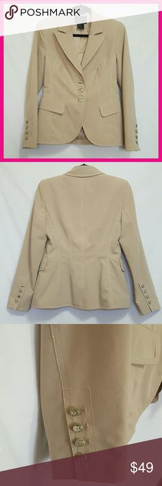 Tailor B. Moss Tan Blazer Tailor B.Moss Clothing Company tan blazer Excellent/Like New condition  Size 4 Shell: 72% Polyester 23% Rayon 5% Spandex Lining: 100% Polyester Flaps on front do not contain open pockets underneath Tailor B. Moss Jackets & Coats Blazers