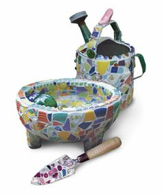 Making Mosaic Garden Art: Turn bits and pieces of broken china and tile into unique garden ornaments. Learn how at http://www.finegardening.com/how-to/articles/making-mosaic-garden-art.aspx