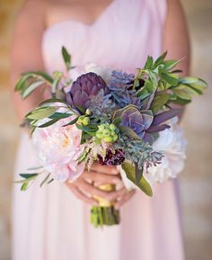 Bridesmaid bouquet with peonies and purple artichoke. I liked the de-emphasis on flowers, here.