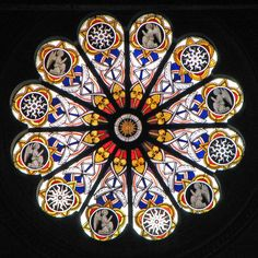 One of seven unique stained glass windows in the church where St. Cahterine of Siena is buried.