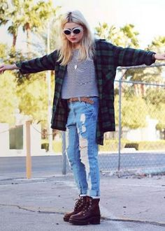 grunge style Loose checked shirt 1950s fashion with stripped top and ripped jeans