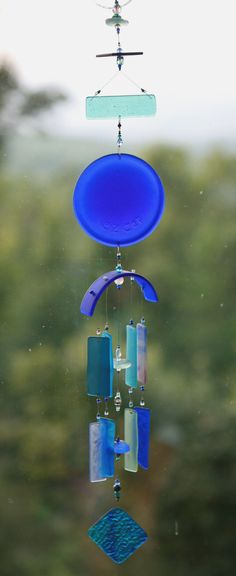 "BLUE LAGOON, Recycled Beach Glass Wind Chime ""One of a Kind"" Hand Made Stained Glass,Ornament, Sun Catcher, windchimes. $45.00, via Etsy."