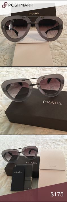 Prada Gray Aviator Sunglasses PR28RS UBV0A7 Lend effortless elegance and glamour to your repertoire with these on trend aviator sunglasses from Prada. A bold, square design adds a touch of vintage which is balanced by the contemporary matte finish while branding at the arms and lens gives a designer finish. Wear with any outfit for instant polish. 100% Authentic  Prada signature on the temple- Dimensions:52mm-22mm-135mm Prada's sleek take on the aviator frames Bold and glamorous - Celebrity…