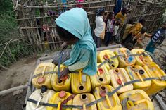 Kid filling jerrycans in Ethiopia Ethiopia, Hand Washing, Kids, Shoes, Young Children, Boys, Zapatos, Shoes Outlet, Shoe