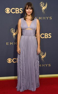 2017 Emmys: Rashida Jones is wearing a lavender J. Mendel dress with small ruffles and a small cutout.The color of this dress is just lovely! This is one of Rashida's best looks! Feminine and classy!