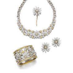 Diamond parure Comprising: a necklace pavé- and collet-set with brilliant-cut…