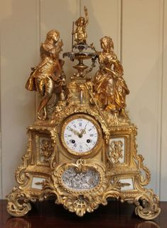 Exquisite detail of French gilt ormolu mantel clock