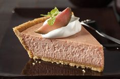 Guava paste adds tropical flavor to this easy-to-make baked cheesecake that's perfect for summer parties.