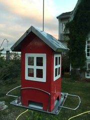 Metallic birdhouse in the garden, Sweden