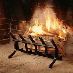 this unique self feeding fireplace grate creates a wall of glowing rh pinterest com Fireplace Andirons Fireplace Andirons