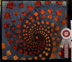 Excellence for Abstract Wallquilt: Cinnamon Swirl by Thelma Robbins