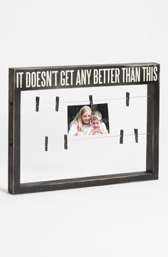 A new way to display your favorite photos--a vintage box frame and clothespins!