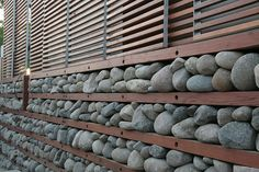 stones used to retain heat in a passive solar heating wall  Visit sustainablehouseandhome.com