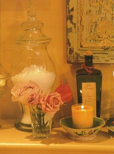 A romantic and aromatic still life for the bath - bathing salts, scented candle, roses, and French fragrance.  Photo (C) Nancy E. Hill from my book 'Bedrooms'