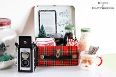 A vintage inspired hot cocoa station for the holidays. Cute ideas for a Christmas display! Love the old Santa mug, vintage camera and plaid school lunchbox! Cute Christmas Gifts, Christmas Gift Baskets, Homemade Christmas Gifts, Merry Little Christmas, Christmas Candles, Retro Christmas, Christmas Holidays, Christmas Decorations, Christmas Ideas