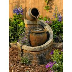 "This is a lovely garden fountain. I love the spiral that ""embraces"" it. From Lamps Plus"