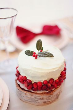 Lovely touch of the winter holidays with the holly sprig and dried cranberries around this mini cake. How darling for dessert at a #Christmas #wedding.