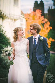 Bride and groom walking, Autumn colours, Wedding Photography, Lavenham