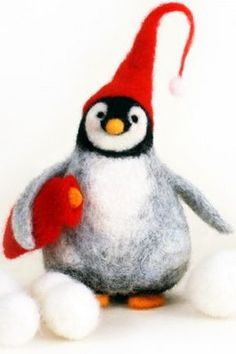 Needle felted penguin in red stocking cap