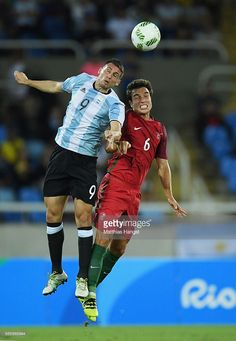 #RIO2016 Jonathan Calleri of Argentina heads the ball over Tomas Martins Podstawski of Portugal during the Men's Group D first round match between Portugal and Argentina during the Rio 2016 Olympic Games at the Olympic Stadium on August 4, 2016 in Rio de Janeiro, Brazil.