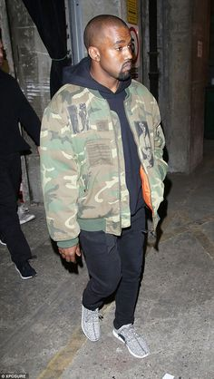 Big day: While Kanye West attended London Fashion Week on Monday, his BET Honors award cer. Kanye West Songs, Celebrity Sneakers, Kanye West Yeezus, Kanye West Style, Yeezy Outfit, Yeezy Season, Season 2, Summer Outfits Men, Camo Jacket
