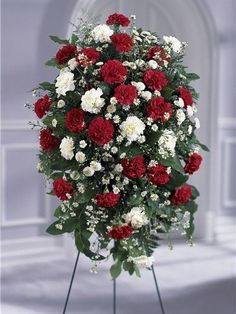 Send your sympathy with The Red and White Standing Spray from Avas Flowers. Your sincere condolences are conveyed using a blend of red and white carnations delivered on an easel, appropriate for a memorial service, or to send to the funeral home. Casket Flowers, Funeral Flowers, Avas Flowers, Small Flowers, Types Of Flower Arrangement, Funeral Floral Arrangements, Funeral Sprays, Memorial Flowers, Cemetery Flowers