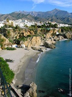 A view of a beach and the mountains from Balcon de Europa in Nerja, Spain. Nerja Spain, Andalucia Spain, Malaga Spain, Places In Spain, Places To Visit, Double Exposure Photography, Levitation Photography, Water Photography, Macro Photography