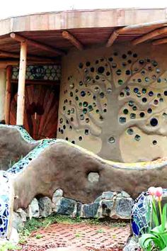 cob house with tree and glass bottles... as long as they let in light :)  decorative and functional