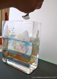 Raining Rainbows Experiment - Fill the glass container about 2/3's full. Next, add a layer of shaving cream. Spread it out so it covers the water's surface. Then, drop food coloring on top of the shaving cream. It's raining rainbows!