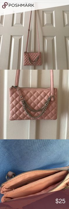 Express crossbody. Express light pink crossbody. With a double pocket. Adjustable strap. Used a few times. Has some darkening around the edges for the strap (pic 5). But in excellent used condition! Really cute for night out. ✅come from a smoke free and pet free home. ✅ open to reasonable offers. EUC. Express Bags