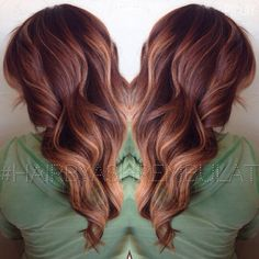 An auburn base color with painted golden blonde balayage highlights #HairByAshRembulat