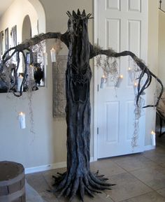 I used a cardboard concrete tube as the bottom of the tree and I had a really long, skinny cardboard box from something I had purchased and it just fit into the concrete tube and I helped stay. Halloween Camping, Halloween Home Decor, Halloween Birthday, Outdoor Halloween, Halloween 2019, Holidays Halloween, Halloween Ideas, Halloween Decorations, Haunted House For Kids