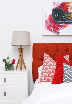 orange linen headboard + mixed patterns