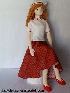 Girl doll in white and red