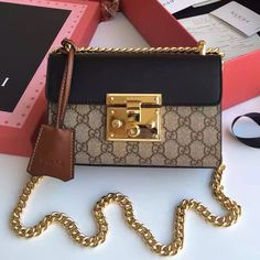 A small structured GG supreme canvas bag with a leather top and our key lock closure. Luxury Purses, Luxury Bags, Luxury Handbags, Fashion Handbags, Gucci Padlock Bag, Gucci Wallet, Designer Bags For Less, Gucci Purses, Gucci Bags