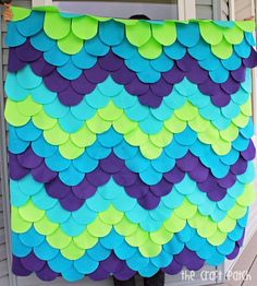 DIY -- Cute gift! It's a bright-colored, funkymermaid scaleblanket. Definitely unique. It's madewith 210pieces of felt layered like shingles, sewn onto a ...