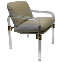 """For Sale on - A glamorous Lucite with polish brass and polish aluminum hardware with off white leather arm chair, This chair is part of the """"Pipeline Series II"""" Lucite Chairs, American Modern, Polished Brass, White Leather, Armchair, Hardware, Deep, Detail, Photos"""