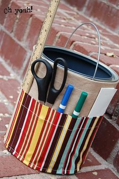 Paint can art caddy. Can be made for any size container for sewing, crafting, writing materials, etc. I love this!