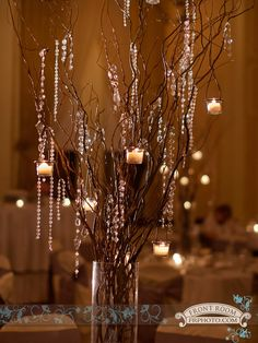 Rachel & Mike chose Manzanita branches dripping with crystals and hanging candles as their aisle decorations and then doubled as centerpieces by SKW Floral and Decor, LLC. Photo by: FRPhoto info@frphoto.com