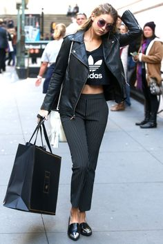 The model wears DVF pinstripe pants, an Adidas crop and leather jacket while out in New York.   - HarpersBAZAAR.com