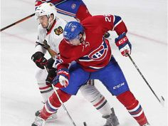 Jan.14 2016 - Chi 2 - Mtl 1 - Montreal Canadiens defenceman Jeff Petry and Chicago Blackhawks defenceman Niklas Hjalmarsson (4) try to get at puck flying through their legs during second period NHL action in Montreal on Thursday January 14, 2016.